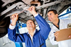 http://www.dreamstime.com/stock-photos-mechanics-working-under-car-image23878413