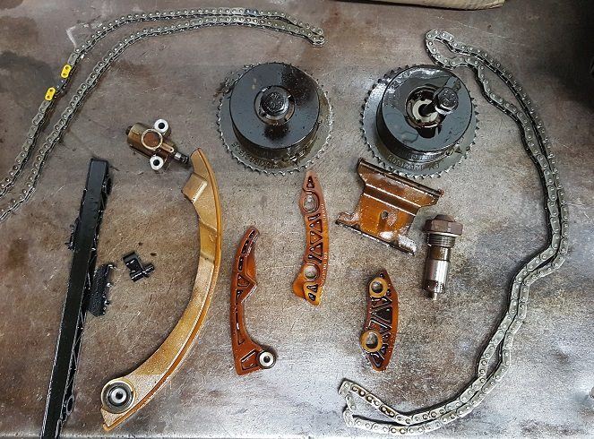 This is the severely worn timing chain and gear from the Chevy Equinox, which had a rear main seal leak.